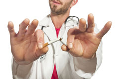 The doctor breaking a cigarette Royalty Free Stock Photo