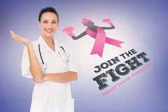 Doctor with breast cancer awareness message Royalty Free Stock Images