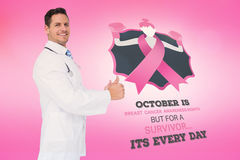 Doctor with breast cancer awareness message Stock Images