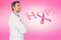 Doctor with breast cancer awareness message Stock Photos