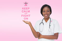 Doctor with breast cancer awareness message Royalty Free Stock Image