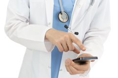 Doctor browsing on smart phone Royalty Free Stock Photos