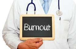 Doctor with burnout sign stock photography