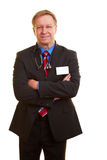 Doctor in a business suit. Doctor with stethoscope and name tag dressing in a business suit royalty free stock images