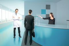 Doctor, businessman and secretary at reception Stock Photos