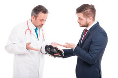 Doctor and businessman with vr gadget Royalty Free Stock Photography