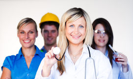 Doctor, businesswoman, engineer and scientist. Multi-profession - Doctor, businesswoman, engineer and scientist smiling at the camera Stock Photography