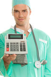 Doctor with calculator. Isolated on white Royalty Free Stock Photos