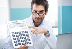 Doctor and calculator Royalty Free Stock Photo