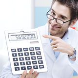 Doctor and calculator Stock Images