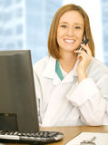 Doctor Calling On Her Desk Stock Photo