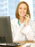 Doctor Calling On Her Desk Stock Photo