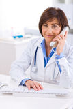 Doctor Calling On Phone Royalty Free Stock Photos