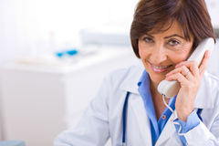 Doctor calling on phone Stock Photos