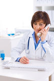 Doctor calling on phone Royalty Free Stock Photo