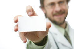 Doctor with card Royalty Free Stock Photography