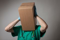 Doctor with cardboard box head Stock Photos