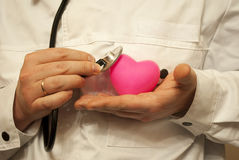 The doctor-cardiologist listens to heart. The vrcha-cardiologist advises to protect the heart Royalty Free Stock Photo