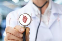 Doctor the cardiologist listens to the heart. stock photos