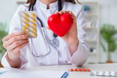 The doctor cardiologist with red heart in the hospital Royalty Free Stock Photos