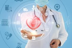 Doctor the cardiologist shows the treatment of heart. stock image