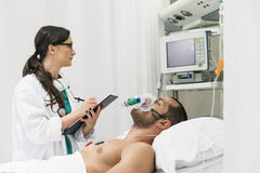 Doctor is caring a sick person Stock Photo