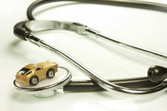 Doctor of cars. Representation of certain work tools of doctor and mechanic Stock Image
