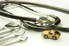Doctor of cars. Representation of certain work tools of doctor and mechanic Royalty Free Stock Photo