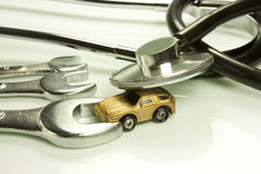 Doctor of cars. Representation of certain work tools of doctor and mechanic Royalty Free Stock Photography