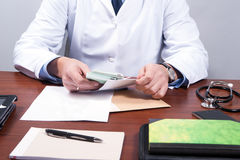 Doctor and cash Royalty Free Stock Image