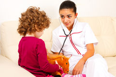 Doctor chatting with her little patient Stock Images