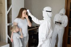 Free Doctor Check Patient Body Temperature Using Infrared Forehead Thermometer Gun At Home. Coronavirus, Covid-19, High Fever Stock Photography - 183606322
