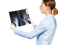 Doctor check`s patients xray over white background Stock Photo