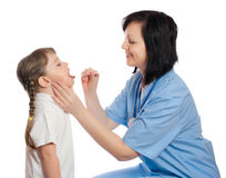 Doctor check throat of girl Royalty Free Stock Images