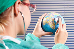 Doctor checkin status health of the earth stock photos
