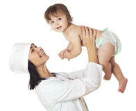 Doctor checking baby with stethoscope on white background Stock Photo