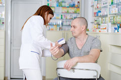 Doctor checking blood pressure Stock Photos