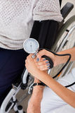 Doctor Checking Blood Pressure Of Patient Royalty Free Stock Image