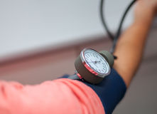 Doctor Checking Blood Pressure Of A Patient Close Up Royalty Free Stock Photography