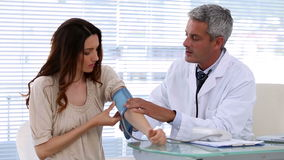Doctor checking blood pressure of the patient Stock Image