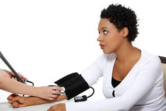 Doctor checking blood pressure of pregnant woman. Doctor checking blood pressure of pregnant woman, isolated on white background Stock Photography