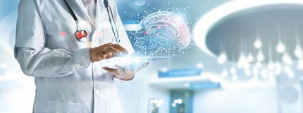 Doctor checking brain testing result with computer interface, in Royalty Free Stock Image