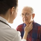 Doctor checking an elderly man Stock Photography