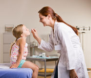 Doctor Checking Girl Temperature Royalty Free Stock Images