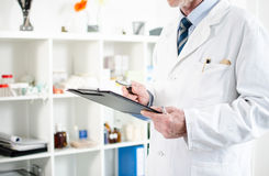 Doctor checking his notes Stock Photography