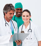 Doctor checking his planning with his colleagues Royalty Free Stock Images
