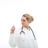Doctor checking hypodermic syringe Stock Photography