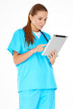 Doctor checking information on a tablet Stock Photos