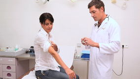 Doctor checking an injection for a patient Royalty Free Stock Photo
