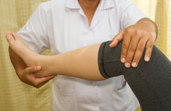 Doctor checking the knee joint Royalty Free Stock Image